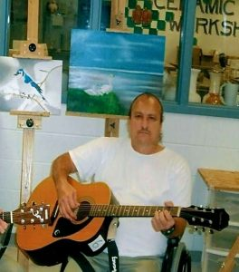 Michael Pelletier, serving life for pot, with his guitar and artwork at USP Terre Haute.