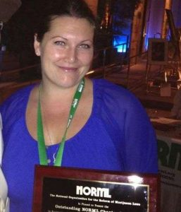 Kandice Hawes accepts the NORML award for outstanding chapter, presented to OC NORML