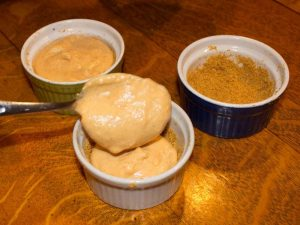 Ramekins being filled with Marijuana Pumpkin Cheesecake Batter