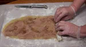 marijuana cookies, rolling the cinnamon roll cookies into a log