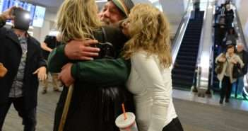 Eddy Lepp is hugged by Aundre Speciale, left, and Karyn Peto, right, at San Francisco International Airport in San Francisco, Calif., on Wednesday, Dec. 7, 2016. Lepp, a major figure in the Bay Area and Northern California marijuana community, was released from federal prison in Colorado after serving 8.5 years for growing marijuana. (Dan Honda/Bay Area News Group)