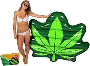 Bikini cladd woan with marijuana leaf pool float