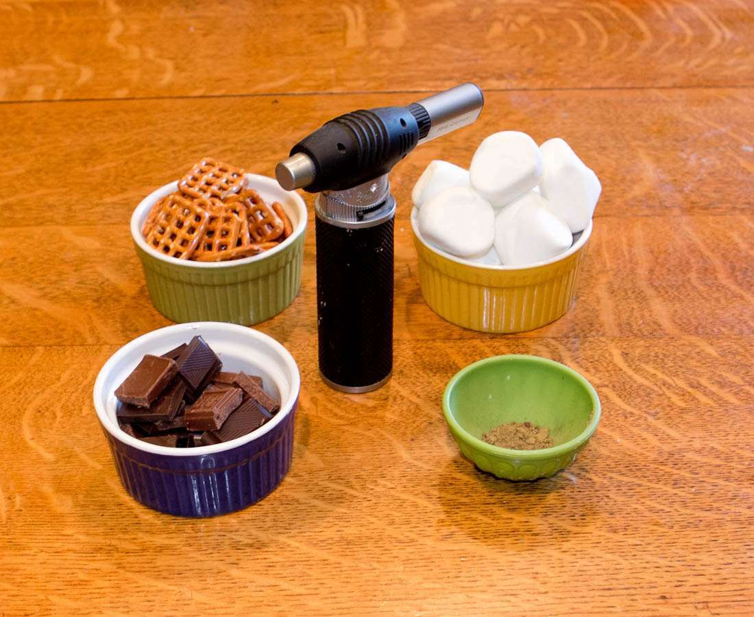 Ingredients and tools for making marijuana pretzel s'mores with a dab torch