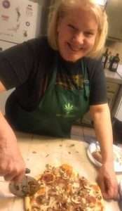 Author Cheri Sicard making pizza